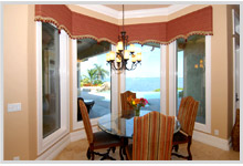 Dining room with a bay window view